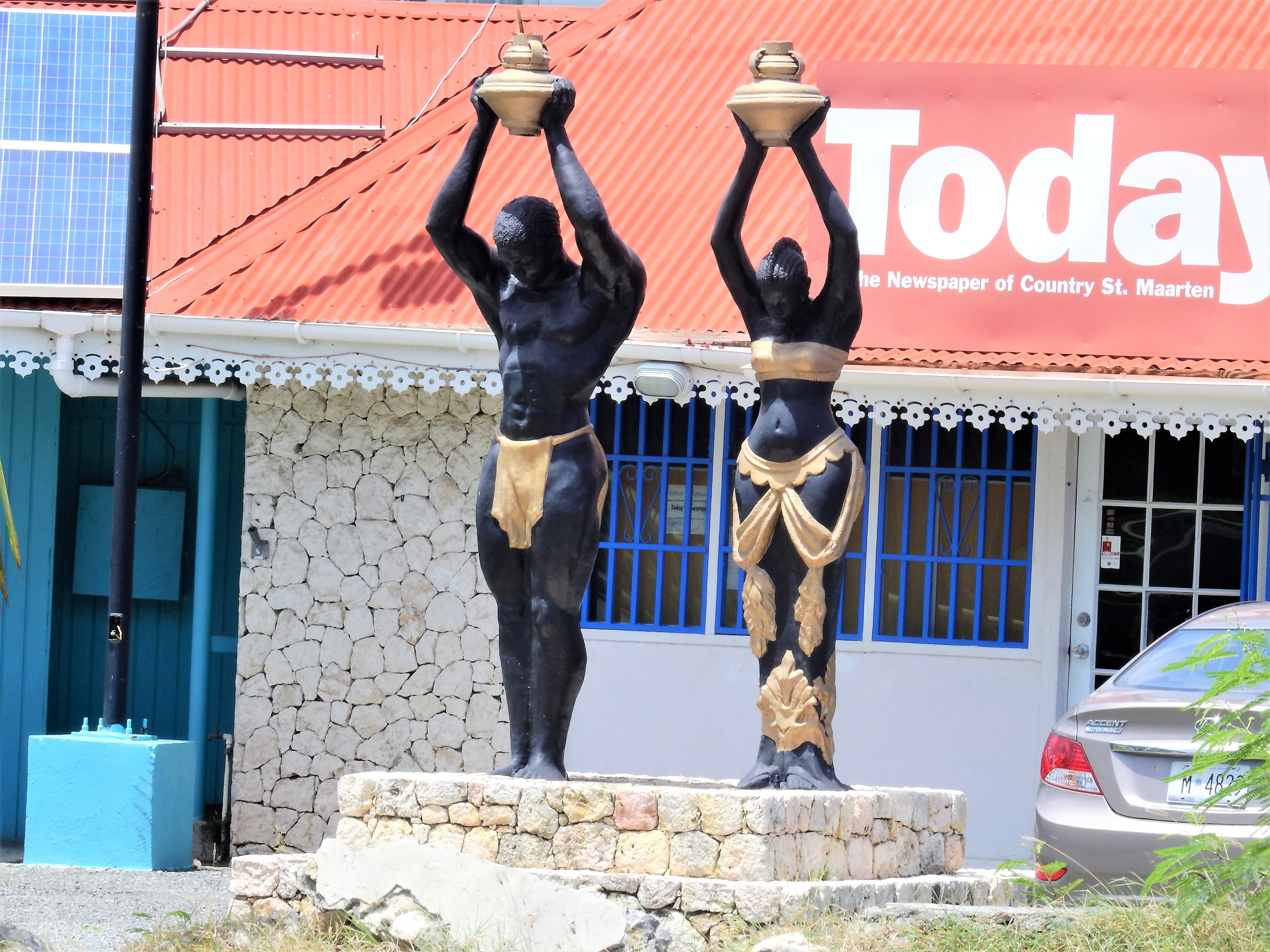 Interesting statues in front of the Today Newspaper office in St. Maarten.