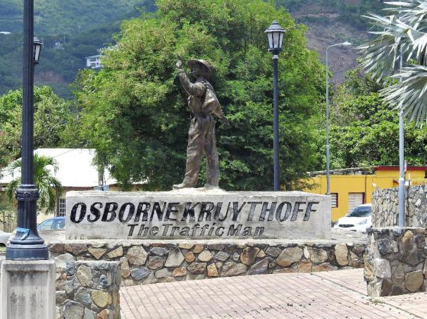 A statue of Osborne Kruythoff - The Traffic Man in Philipsburg, Sint Maarten.
